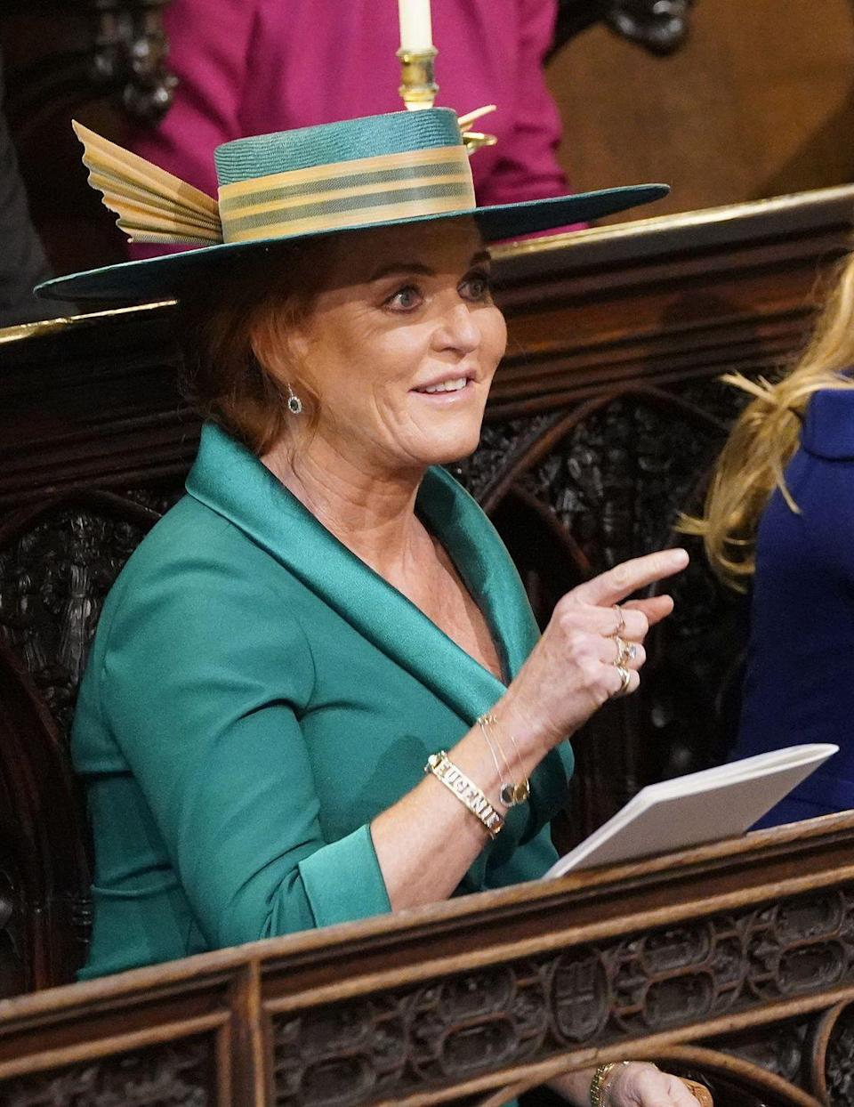 """<p>Maybe <a href=""""https://www.goodhousekeeping.com/life/a23731030/sarah-ferguson-princess-eugenie-wedding-dress/"""" rel=""""nofollow noopener"""" target=""""_blank"""" data-ylk=""""slk:Sarah Ferguson's hat"""" class=""""link rapid-noclick-resp"""">Sarah Ferguson's hat</a> <em>was </em>a little wild at Princes Eugenie's royal wedding, but the sweetest gesture ever was her tribute to her two daughters, Princesses Beatrice and Eugenie. The mother of the bride wore a <a href=""""https://www.goodhousekeeping.com/beauty/fashion/a23890165/sarah-ferguson-eugenie-bracelet-jewelry-royal-wedding/"""" rel=""""nofollow noopener"""" target=""""_blank"""" data-ylk=""""slk:gorgeous bangle with her daughter's names"""" class=""""link rapid-noclick-resp"""">gorgeous bangle with her daughter's names</a> written in diamonds. Dare we say it? Who cares what else you're wearing when you've got that kind of Mom bling on your wrist?</p>"""