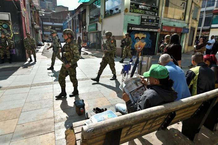 Soldiers patrol the streets of Bogota after a curfew imposed to stop looting is lifted (AFP Photo/JUAN BARRETO )