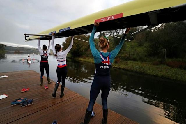 British rowers prepare for an early morning session on the lake during a training camp in Avis, central Portugal (AFP Photo/ADRIAN DENNIS)