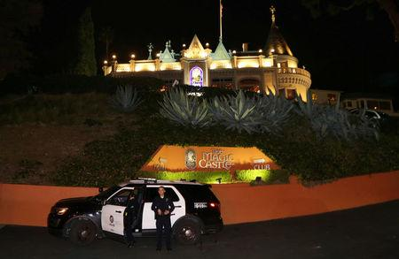 FILE PHOTO - Los Angeles Police Department (LAPD) officers control the entrance at the Magic Castle magicians' club in the Hollywood neighborhood of Los Angeles, California, U.S. February 24, 2017.  REUTERS/Chris Helgren/File Photo