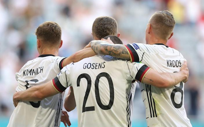 Robin Gosens of Germany celebrates with Joshua Kimmich and Toni Kroos after scoring their side's fourth goal during the UEFA Euro 2020 Championship Group F match between Portugal and Germany at Football Arena Munich on June 19, 2021 in Munich - GETTY IMAGES