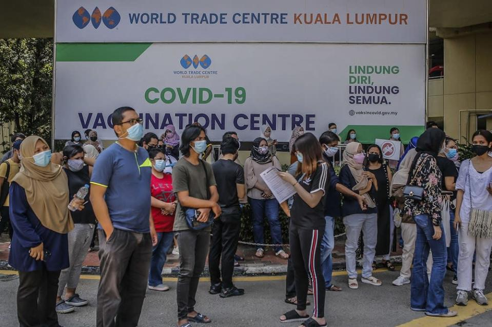 People wait to receive their AstraZeneca Covid-19 vaccine shot at the Vaccine Delivery Centre located at Kuala Lumpur World Trade Centre May 29, 2021. — Picture by Hari Anggara