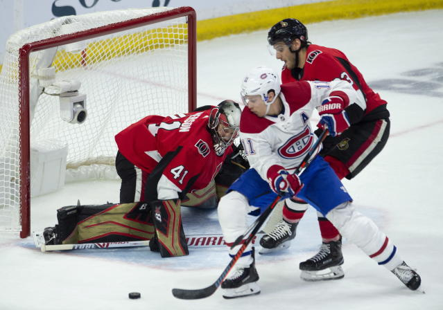 Ottawa Senators goaltender Craig Anderson defends as defenseman Christian Jaros pressure Montreal Canadiens right wing Brendan Gallagher as he tries to get a shot during the second period of an NHL game in Ottawa, Ontario, Saturday, Oct. 20, 2018. (Adrian Wyld/The Canadian Press via AP)