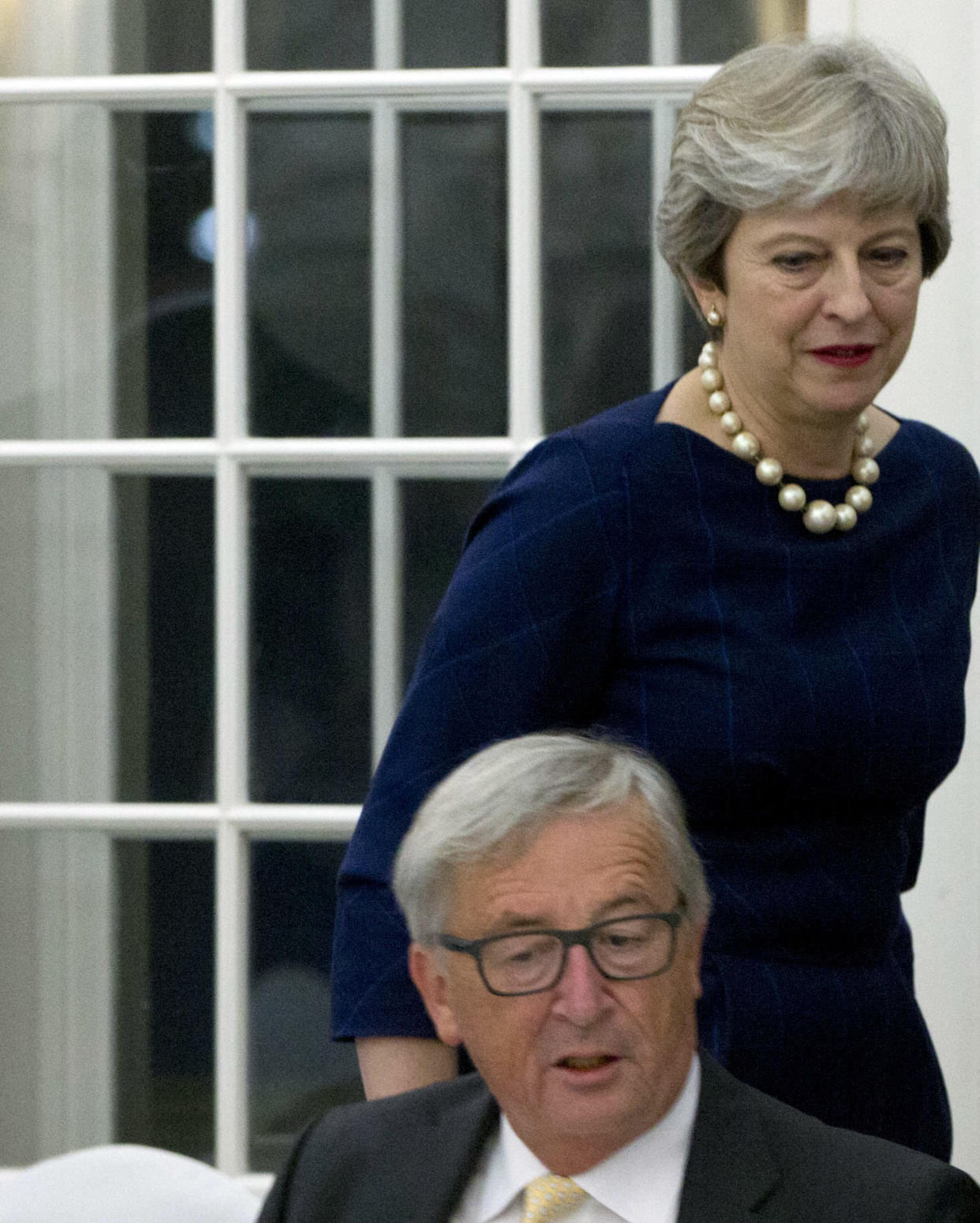 <em>Brexit drama – British Prime Minister Theresa May, right, walks past European Commission President Jean-Claude Juncker (Picture: AP)</em>