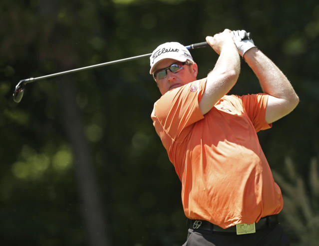 Brad Fritsch, of Canada, watches his tee shot on the second hole during the third round of the Wyndham Championship golf tournament in Greensboro, N.C., Saturday, Aug. 16, 2014. (AP Photo/Chuck Burton)