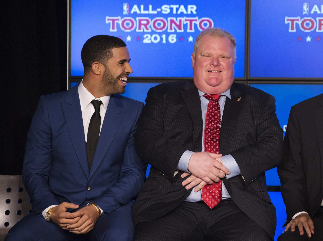 Rapper Drake (L) sits with Toronto Mayor Rob Ford during an announcement that the Toronto Raptors will host the 2016 NBA All-Star game in Toronto, September 30, 2013. Toronto was selected as the host of the National Basketball Association's (NBA) 2016 All-Star Game, marking the first time the showcase event will be held outside of the United States, the league said on Monday. REUTERS/Mark Blinch (CANADA - Tags: SPORT BASKETBALL ENTERTAINMENT POLITICS)