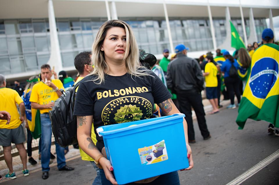 """BRASILIA, BRAZIL - MAY 09: Sara Winter, the leader of the extreme right group """"300 do Brasil"""" and supporter of Brazilian President Jair Bolsonaro, reacts during a motorcade and protest against the National Congress and the Supreme Court over lockdown measures amidst the coronavirus (COVID-19) pandemic at the Planalto Palace on May 09, 2020 in Brasilia.Sara Winter was arrested on June 15 by the Federal Police as part of an investigation into the financing of anti-democratic protests.(Photo by Andressa Anholete/Getty Images)"""