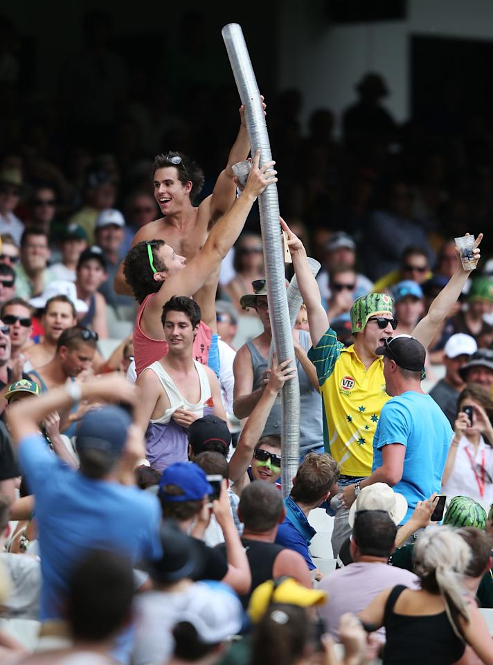MELBOURNE, AUSTRALIA - DECEMBER 27:  Spectators create a tube from their empty cups during day two of the Second Test match between Australia and Sri Lanka at Melbourne Cricket Ground on December 27, 2012 in Melbourne, Australia.  (Photo by Michael Dodge/Getty Images)