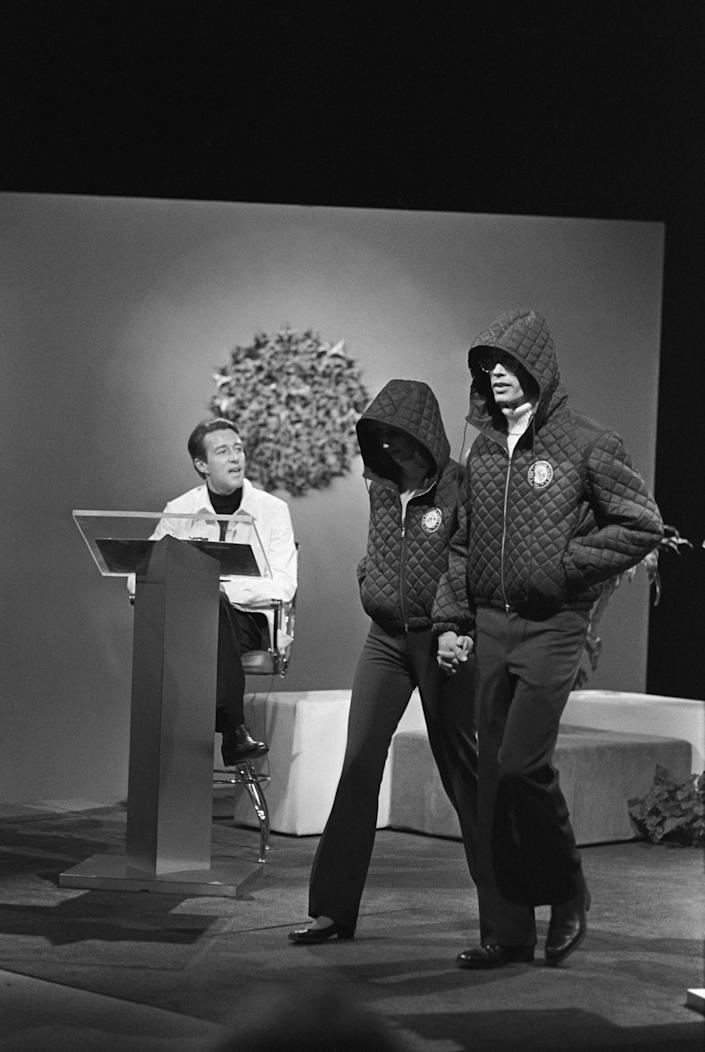 Halston presents outfits designed with Montgomery Ward for the 1976 Innsbruck Winter Olympics during a televised fashion show in Washington, D.C. - Credit: Fairchild Archive/Penske Media
