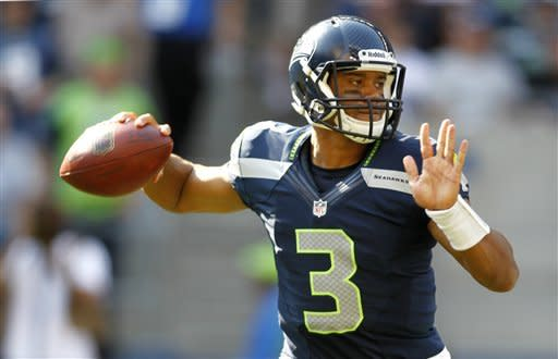 Seattle Seahawks quarterback Russell Wilson drops back to pass against the Dallas Cowboys in the second half of an NFL football game on Sunday, Sept. 16, 2012, in Seattle. (AP Photo/John Froschauer)