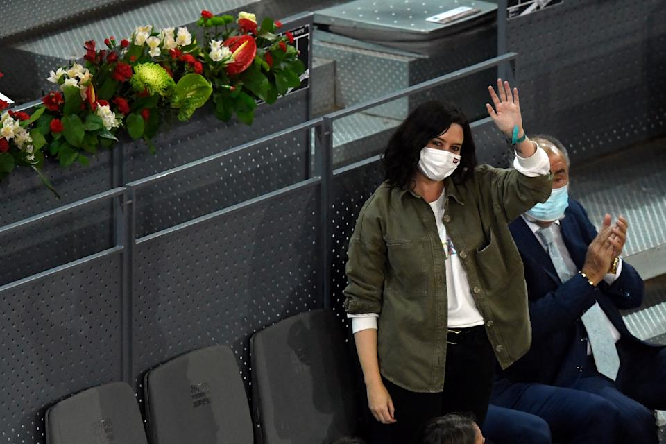 Madrid's regional president Isabel Diaz Ayuso waves as she attends the 2021 ATP Tour Madrid Open tennis tournament singles final match at the Caja Magica in Madrid on May 9, 2021. (Photo by OSCAR DEL POZO / AFP) (Photo by OSCAR DEL POZO/AFP via Getty Images)