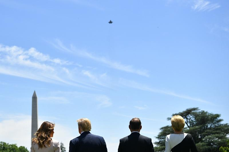 US President Donald Trump, his Polish counterpart Andrzej Duda and their wives watch a US F-35 warplane during a White House meeting that saw them boost military cooperation (AFP Photo/MANDEL NGAN)