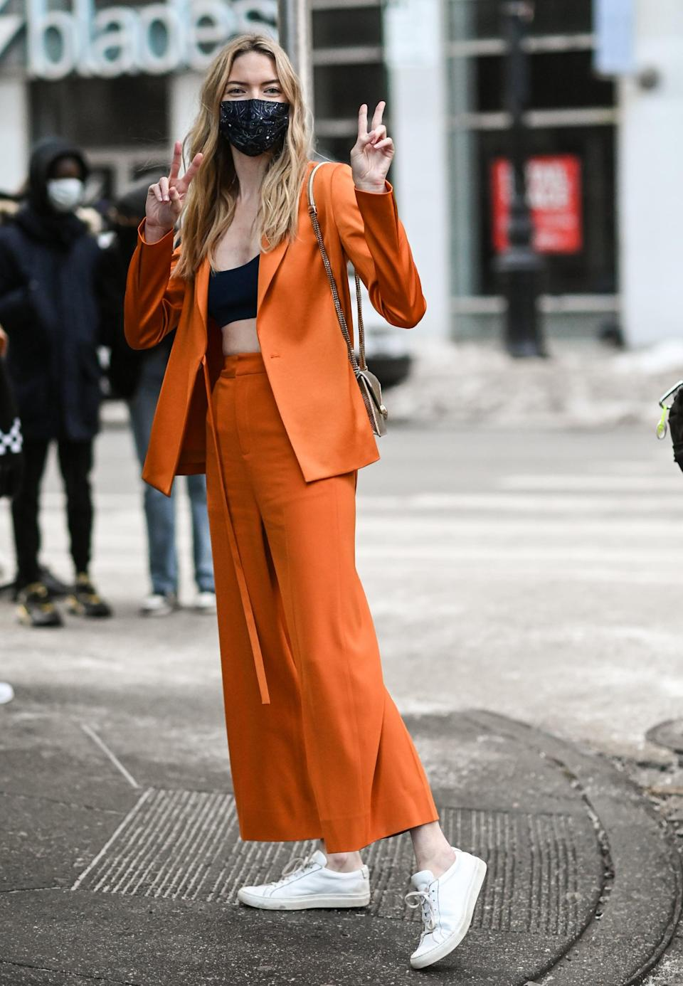 <p>Sometimes, unexpected combos just work. This print orange suit is perfect for spring, and the paisley mask is subtle enough that it doesn't compete.</p>