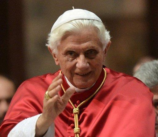 Pope Benedict XVI waves to worshippers after a celebration at Milan's Cathedral as part of the 7th World Meeting of Families. The pope has insisted that celibacy is central to the priesthood, amid increasing calls for clergy to be allowed to marry and claims that abstention may have contributed to sex abuse scandals