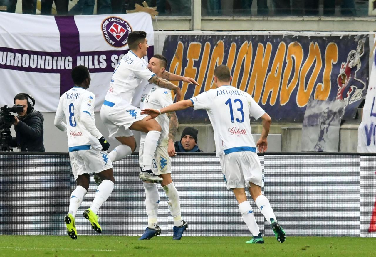Empoli's midfielder Rade Krunic, second from right, celebrates with teammates after scoring his team's first goal, during the Italian Serie A soccer match between Fiorentina and Empoli, at the Artemio Franchi stadium in Florence, Italy, Sunday, Dec. 16, 2018. (Claudio Giovannini/ANSA via AP)