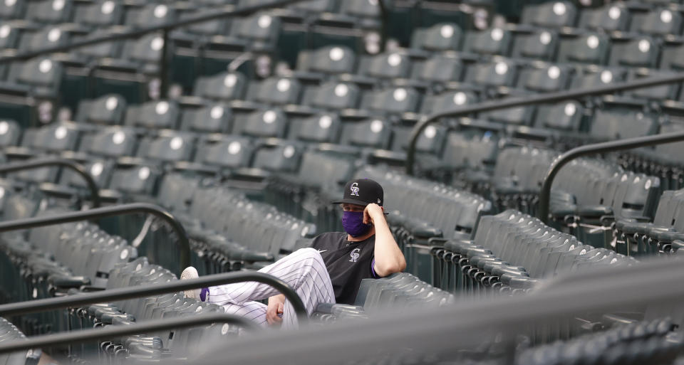 Colorado Rockies relief pitcher Scott Oberg looks on from the right-field stands in the first inning of a baseball game against the San Diego Padres Friday, July 31, 2020, in Denver. (AP Photo/David Zalubowski)