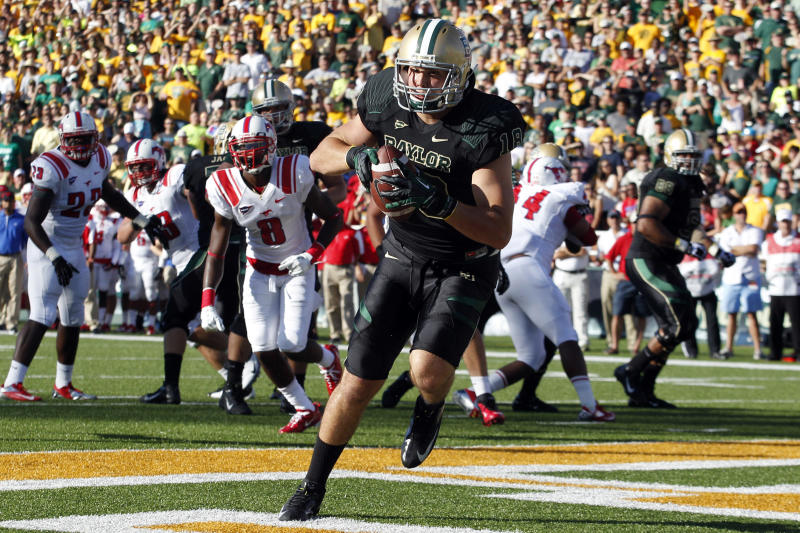Baylor tight end Jordan Najvar (18) pulls in a touchdown pass during the first half of an NCAA college football game against Southern Methodist in Waco, Texas, Sunday, Sept. 2, 2012. (AP Photo/LM Otero)