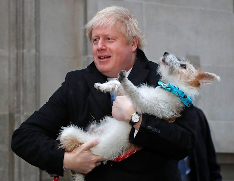 <strong>The prime minister holding his dog Delyn on election day&nbsp;</strong> (Photo: ASSOCIATED PRESS)