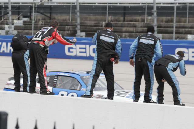 The crew of Chase Briscoe cheers as Briscoe drives by after winning the NASCAR Xfinity series auto race Thursday, May 21, 2020, in Darlington, S.C. (AP Photo/Brynn Anderson)