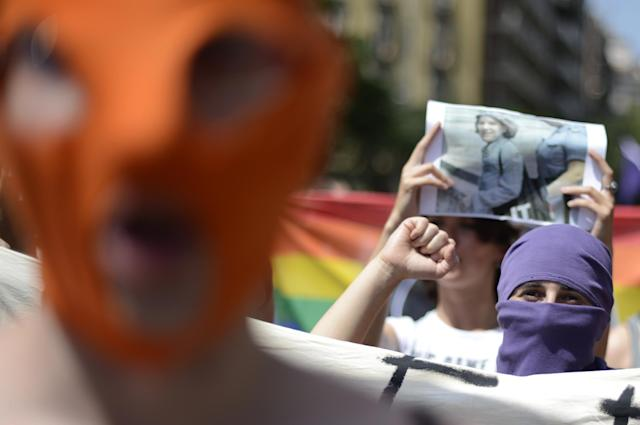 Demonstrators shout slogans in support of the Russian punk group Pussy Riot during a protest in front of the Sagrada Familia church designed by architect Antoni Gaudi in Barcelona, Spain, Friday, Aug. 17, 2012. Three members of Pussy Riot were jailed in March and charged with hooliganism motivated by religious hatred after their punk performance against President Putin in Moscow's main cathedral. (AP Photo/Manu Fernandez)