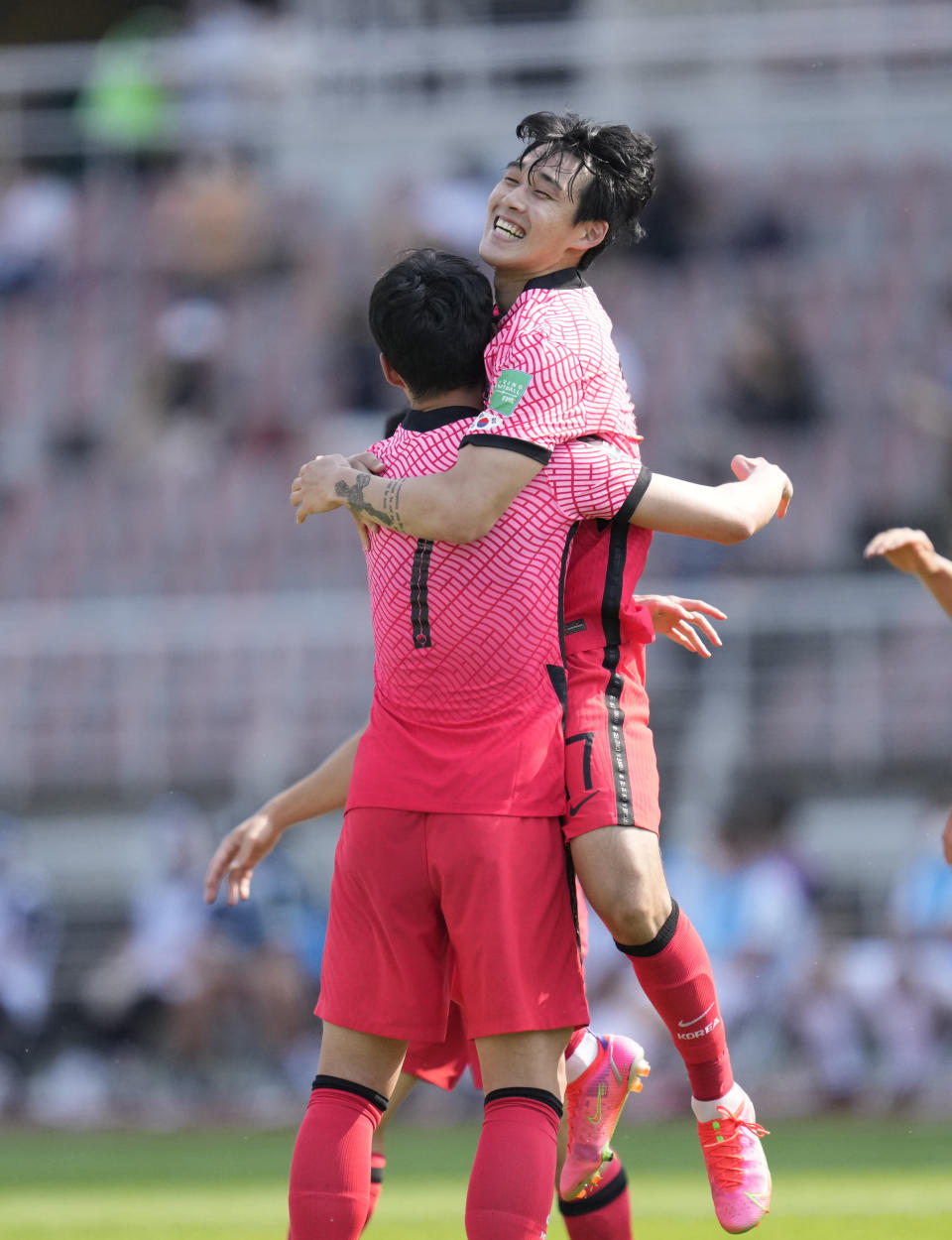 South Korea's Song Min-kyu celebrates with Son Heung-min (7) after scoring his side's first goal against Lebanon during their Asian zone Group H qualifying soccer match for the FIFA World Cup Qatar 2022 at Goyang stadium in Goyang, South Korea, Sunday, June 13, 2021. (AP Photo/Lee Jin-man)