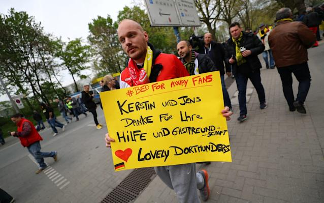 <span>Monaco fans hold banners thanking Dortmund fans for their hospitality before the match</span> <span>Credit: Kai Pfaffenbach/REUTERS </span>