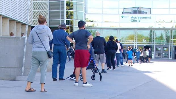 The lineup for people seeking COVID-19 tests extended well out the doors of Edmonton's Expo Centre on Tuesday.  (John Shypitka/CBC News - image credit)