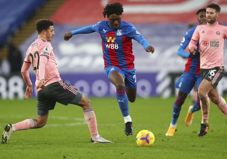Crystal Palace's Eberechi Eze, center, scores his side's second goal during the English Premier League soccer match between Crystal Palace and Sheffield United in London, England, Saturday, Jan. 2, 2021. (Clive Rose/Pool via AP)