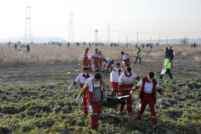 Rescue workers recover the bodies of victims of a Ukrainian plane crash in Shahedshahr, southwest of the capital Tehran, Iran, Wednesday, Jan. 8, 2020.(Photo: Ebrahim Noroozi/AP)