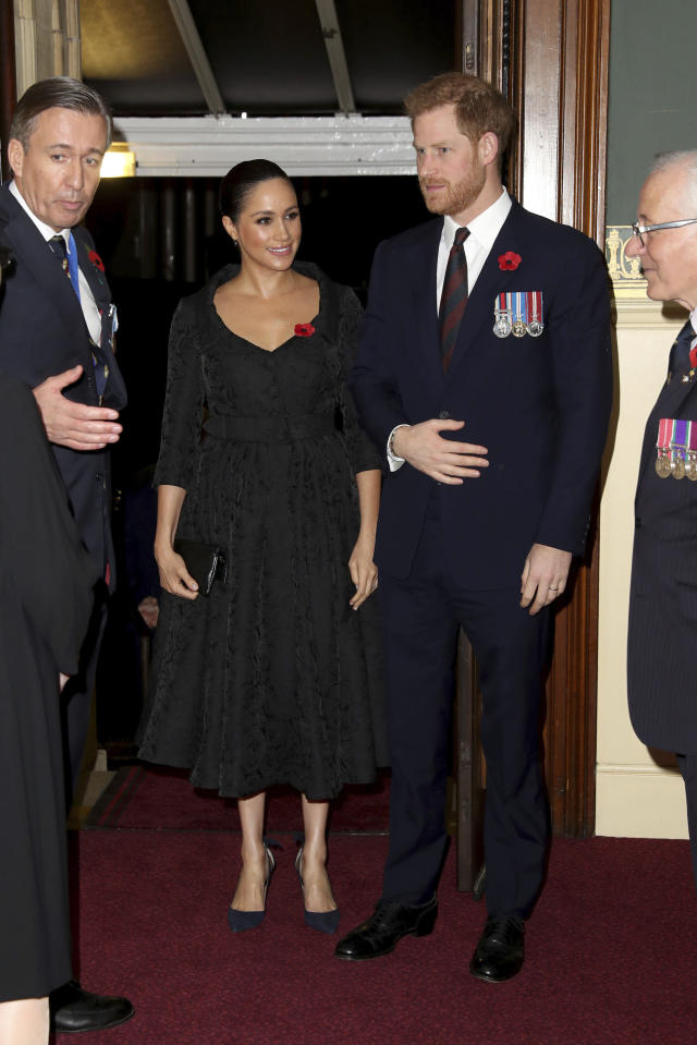 The Duke and Duchess of Sussex attend the annual Royal British Legion Festival of Remembrance at the Royal Albert Hall in Kensington, London on Saturday, Nov. 9, 2019. (Chris Jackson/Pool via AP)