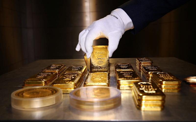 Gold bars on a table - MICHAEL DALDER /REUTERS