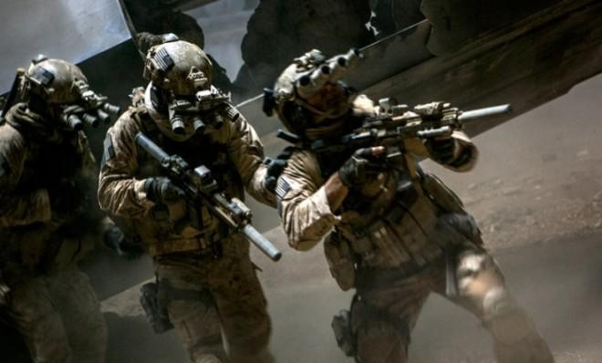 Navy SEALS, as portrayed in Kathryn Bigelow's Zero Dark Thirty, enter Osama Bin Laden's compound.