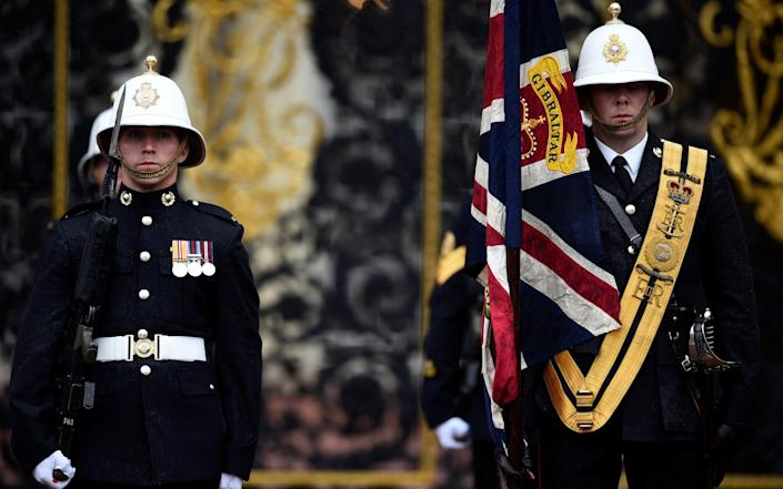 Royal Marines prepare for a parade attended by Britain's Prince Philip