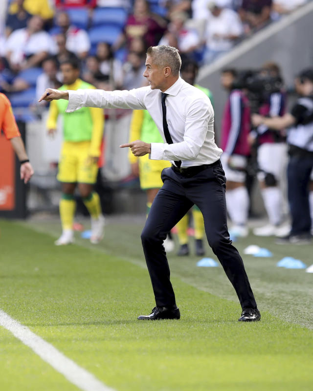 Lyon's coach Sylvinho gestures during the French League 1 soccer match between Lyon and Nantes, at the Stade de Lyon in Decines, outside Lyon, France, Saturday, Sept. 28, 2019. (AP Photo/Laurent Cipriani)