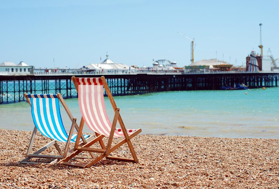 deck chairs on the beach Brighton England with blue sky
