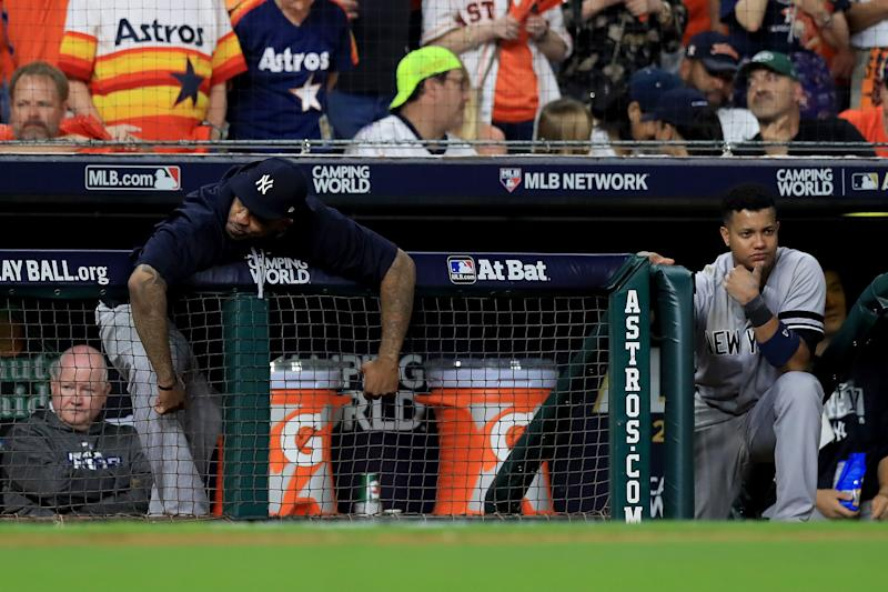 HOUSTON, TX - OCTOBER 21: CC Sabathia #52 and Starlin Castro #14 of the New York Yankees reacts from the dugout against the Houston Astros during the eighth inning in Game Seven of the American League Championship Series at Minute Maid Park on October 21, 2017 in Houston, Texas. (Photo by Ronald Martinez/Getty Images)