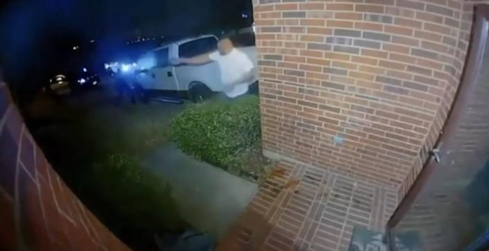 Screenshot footage of Charles Williams, Jr. and Corinth police officers engaged in a shoot-out at Williams' home in a Dallas suburb.
