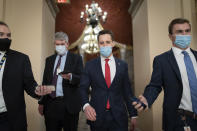 FILE - In this Jan. 6, 2021, file photo after violent protesters loyal to President Donald Trump stormed the U.S. Capitol today, Sen. Josh Hawley, R-Mo., walks to the House chamber to challenge the results of the presidential election in Pennsylvania during the joint session of the House and Senate to count the Electoral College votes cast in November's election, at the Capitol in Washington. (AP Photo/J. Scott Applewhite, File)
