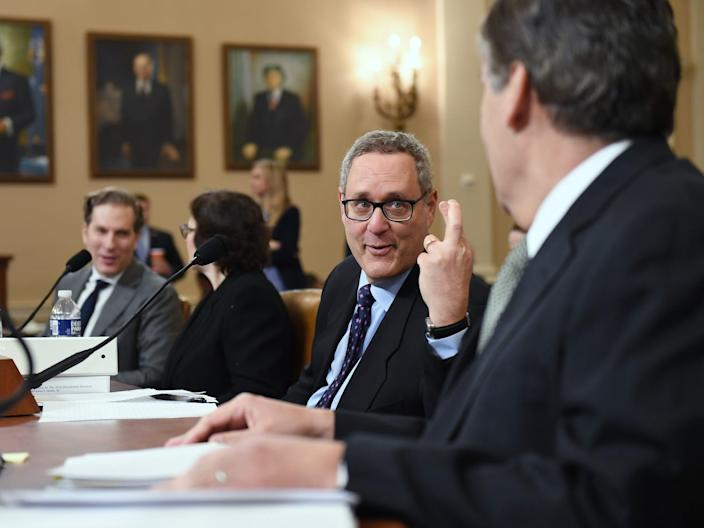 Professors Noah Feldman, left to right, Pamela S. Karlan, Michael Gerhardt, and Jonathan Turley are seen following a break during a House Judiciary Committee Impeachment Inquiry hearing at the Longworth House Office Building on Wednesday December 04, 2019 in Washington, DC.