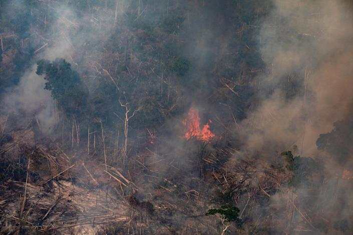 In this aerial image, a fire burns in a section of the Amazon rain forest on August 25, 2019 in the Candeias do Jamari region near Porto Velho, Brazil. (Photo: Victor Moriyama/Getty Images)