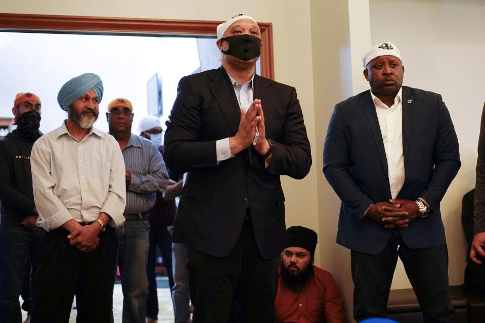 Rep. Andre Carson, D-Ind., speaks with members of the Sikh Coalition at the Sikh Satsang of Indianapolis in Indianapolis, Saturday, April 17, 2021 for a commemoration of the victims of the shooting at a FedEx facility in Indianapolis that claimed the lives of several members of the Sikh community. A gunman killed and wounded several people before taking his own life in a late-night attack at a FedEx facility near the Indianapolis airport. (AP Photo/AJ Mast)