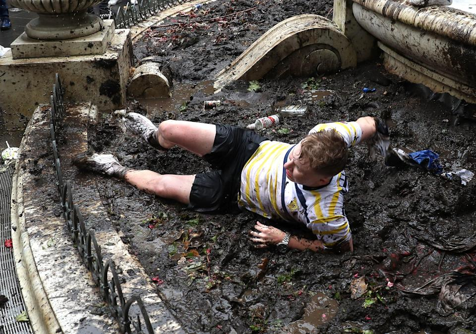 Peaked too soon? One fan was pictured rolling around in the mud. (PA)