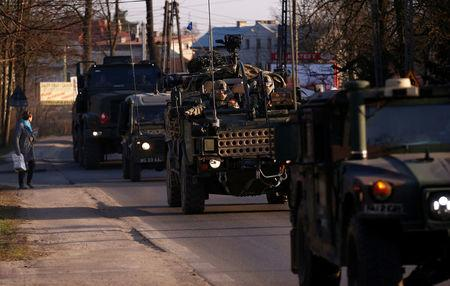 A convoy of troops, a part of NATO's reinforcement of its eastern flank, who are on their way from Germany to Orzysz in northeast Poland, drives through Sulejowek towards a military base in Wesola, near Warsaw, Poland, March 28, 2017. REUTERS/Kacper Pempel