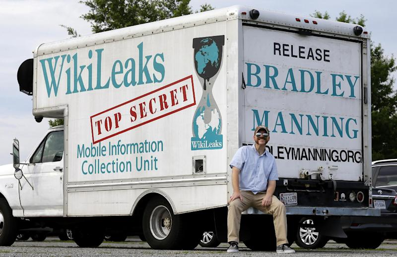 In this June 17, 2013 photo, Clark Stoeckley poses with a box truck in Fort Meade, Md., that he painted in support of Army Pfc. Bradley Manning. Stoeckley a supporter of Pfc. Manning has been accused of posting threatening messages on the Internet and a judge has banned him from the courtroom for the rest of the soldier's trial. Manning is being tried by Judge Denise Lind, an Army colonel, on charges he leaked hundreds of thousands of government documents to the anti-secrecy site WikiLeaks. (AP Photo/Patrick Semansky, File)