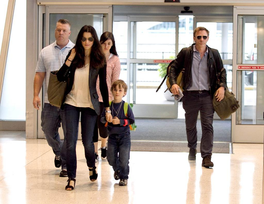 """Newlyweds Rachel Weisz and Daniel Craig always keep their kids close! After tying the knot in a private ceremony with his teen daughter, Ella, and her young son, Henry, in attendance on June 22, the family was photographed together again while departing the Big Apple. Butters/Massie/<a href=""""http://www.splashnewsonline.com"""" target=""""new"""">Splash News</a> - August 4, 2011"""