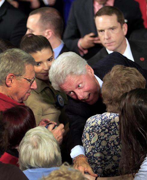 Former President Bill Clinton reaches in for a handshake as he campaigns for President Barack Obama at the University of New Hampshire, Wednesday, Oct. 3, 2012, in Durham, NH (AP Photo/Jim Cole)