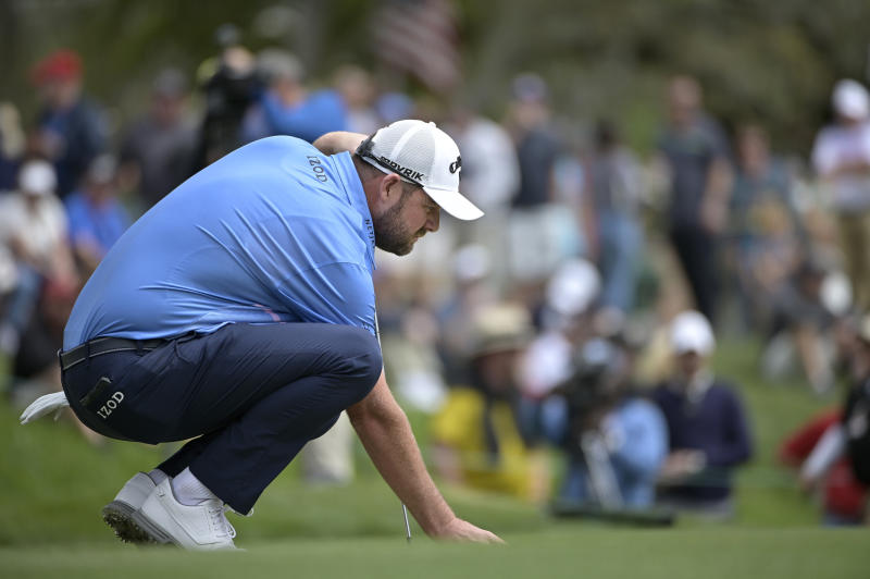 Marc Leishman, of Australia, lines up a putt on the second green during the final round of the Arnold Palmer Invitational golf tournament, Sunday, March 8, 2020, in Orlando, Fla. (AP Photo/Phelan M. Ebenhack)