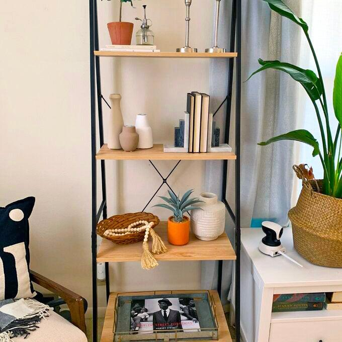 "<h2>Mercury Row Almanzar Metal Ladder Bookcase</h2><br>Maintaining an organized space is more important than ever (now that we are stuck inside our spaces 24/7) — and our readers' top choice for getting the job done was this here Wayfair steal that boasts a whopping 9,000+ reviews. After being featured as <a href=""https://www.refinery29.com/en-us/what-to-buy-with-100-dollars#slide-16"" rel=""nofollow noopener"" target=""_blank"" data-ylk=""slk:one of our teammate's go-to under-$100 buys"" class=""link rapid-noclick-resp"">one of our teammate's go-to under-$100 buys</a> AND <a href=""https://www.refinery29.com/en-us/2020/09/10045005/bestselling-wayfair-way-day-sale-reviews-2020#slide-4"" rel=""nofollow noopener"" target=""_blank"" data-ylk=""slk:a most wanted score from Way Day"" class=""link rapid-noclick-resp"">a most wanted score from Way Day</a> (with real pictures featured!), it quickly rose to bestselling fame in September. <br><br><em>Shop <strong><a href=""https://www.wayfair.com/furniture/pdp/mercury-row-almanzar-7087-h-x-2362-w-metal-ladder-bookcase-mcrw7414.html"" rel=""nofollow noopener"" target=""_blank"" data-ylk=""slk:Mercury Row"" class=""link rapid-noclick-resp"">Mercury Row</a></strong></em><br><br><strong>Mercury Row</strong> Almanzar 70.87"" H x 23.62"" W Metal Ladder Bookcase, $, available at <a href=""https://go.skimresources.com/?id=30283X879131&url=https%3A%2F%2Fwww.wayfair.com%2Ffurniture%2Fpdp%2Fmercury-row-almanzar-7087-h-x-2362-w-metal-ladder-bookcase-mcrw7414.html"" rel=""nofollow noopener"" target=""_blank"" data-ylk=""slk:Wayfair"" class=""link rapid-noclick-resp"">Wayfair</a>"