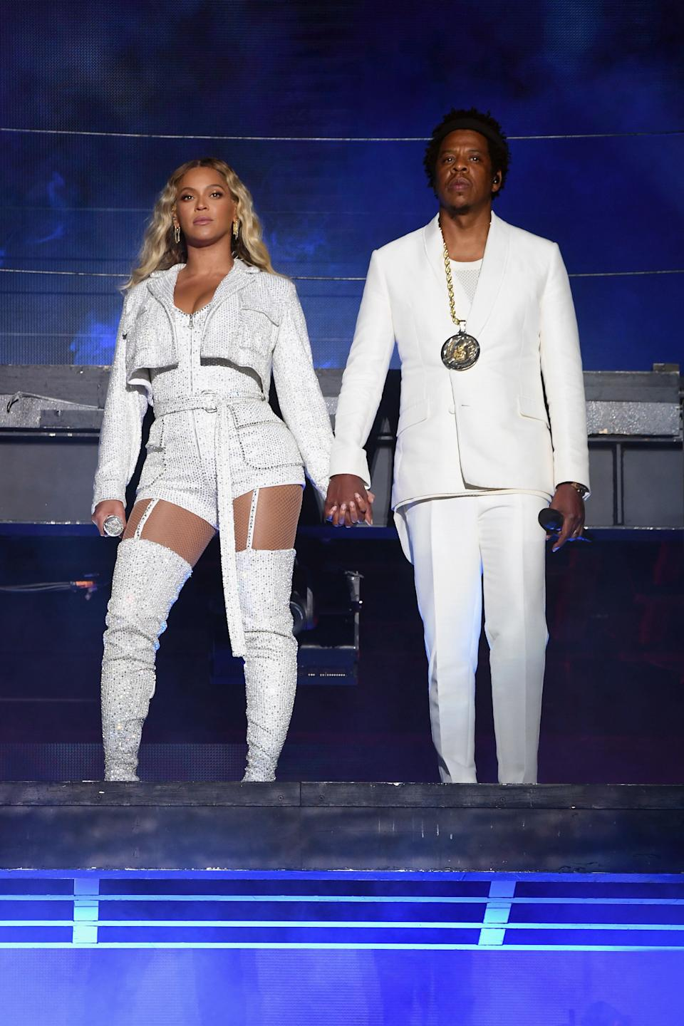 Beyoncé and Jay Z make up one of the most stylish couples around. It makes sense, then, that when they decide to tour together, their show costumes are perfectly coordinated. In this photo, the two stand on stage during a performance in Cleveland in 2018.