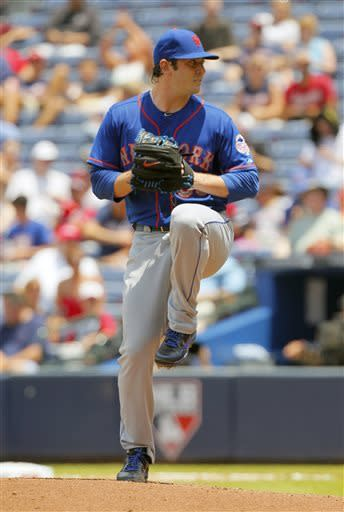 New York Mets starting pitcher Matt Harvey throws in the fourth inning of the first baseball game of a doubleheader against the Atlanta Braves, Tuesday, June 18, 2013, in Atlanta. (AP Photo/Todd Kirkland)